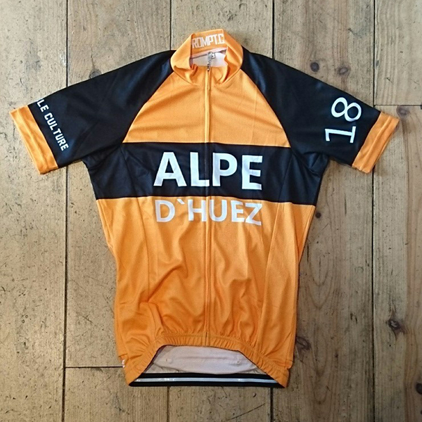 <p>Our tribute to the classic 1960 Molteni Jersey. </p><ul><li>Orange Jersey with black and white writing<li>C40 SQUARE DRY 140 GSM fabric</li><li>Lightweight quick drying micro fibre.</li><li>Wicks moisture from your body.</li><li>Exceptional soft feel, lightweight, odour and bacteria resistant.</li></ul><p><img src='http://www.prompt.cc/images/ss_jersey_sizing.jpg' width='500' height='374' /><p>All sizes are European Race cut so you may wish to order up a size.</p>