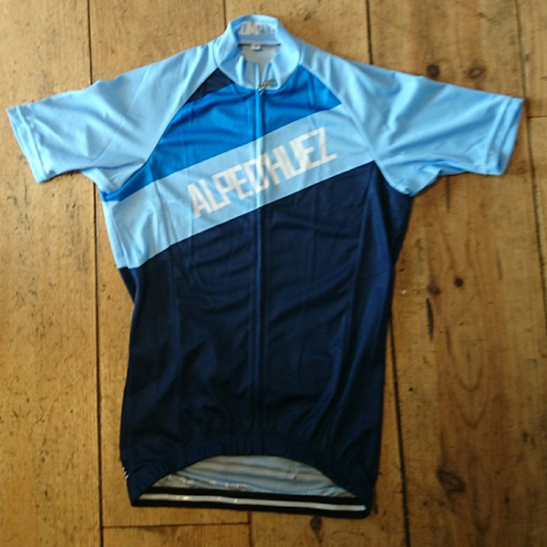 <p>The diagonal Alpe d&#39;Huez Jersey. </p><ul><li>French Blue Jersey with stripes and white writing<li>C40 SQUARE DRY 140 GSM fabric</li><li>Lightweight quick drying micro fibre.</li><li>Wicks moisture from your body.</li><li>Exceptional soft feel, lightweight, odour and bacteria resistant.</li></ul><p><img src='http://www.prompt.cc/images/ss_jersey_sizing.jpg' width='500' height='374' /><p>All sizes are European Race cut so you may wish to order up a size.</p>